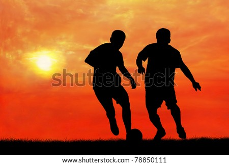 two soccer players catching the ball - stock photo