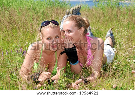 Two sports girls communicate and are secretive - stock photo