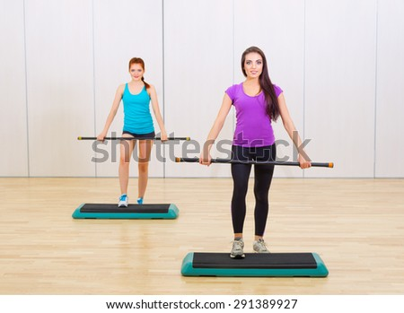 Two sporty young girls at fitness club - stock photo