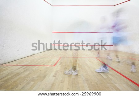 Two squash players in motion blur playing - stock photo