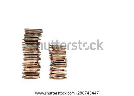 Two stacks of coins against white for use in financial and banking concepts. - stock photo