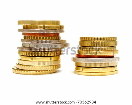 Two stacks of coins isolated on white: one short and one taller - stock photo