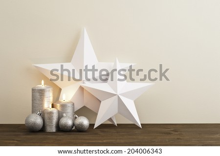 Two stars with silver candles Christmas baubles - stock photo