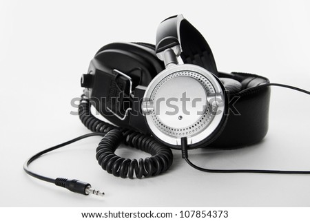 Two, stereo, high quality headphones isolated on white background - stock photo