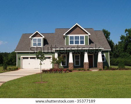 Two story residential home board siding on the facade. - stock photo