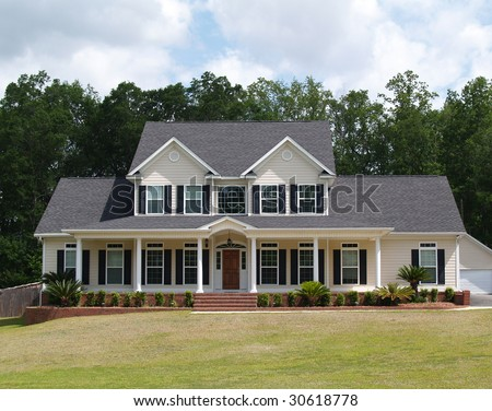 Two story residential home with with board siding on the facade. - stock photo
