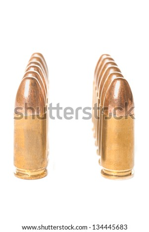 Two straight rows of scratched 9mm bullets isolated on white background - stock photo