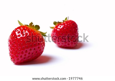 Two strawberries isolated on white background - stock photo