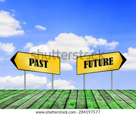Two street signs FUTURE and PAST with beautiful blue sky with cloud closeup and green wooden floor - stock photo