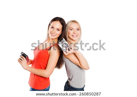 Two students girl with photocamera. Students concept. Isolated on white - stock photo