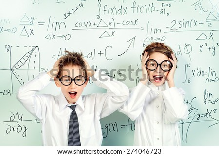 Two students stand by the school board in the laboratory and shouting. Science and education.  - stock photo