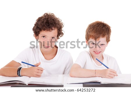Two students with a pencil, writing, isolated on white background - stock photo