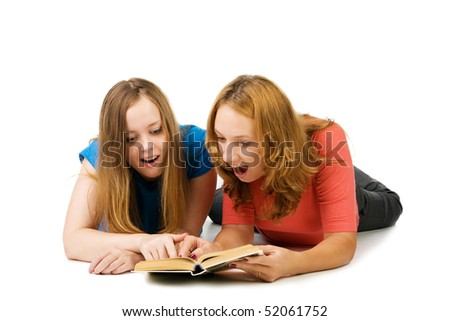 Two surprised girls read the book, isolated on white - stock photo