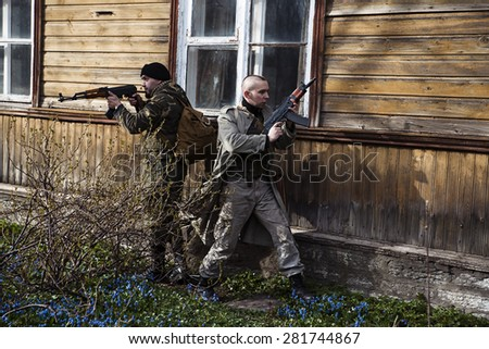 Two surrounded hitman are about to attack - stock photo