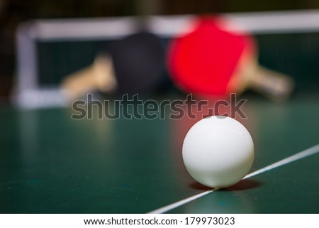 Two table tennis or ping pong rackets and balls  - stock photo