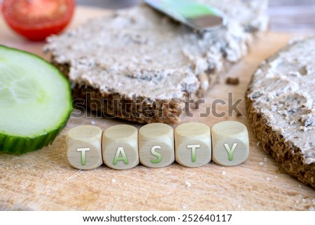 Two Tasty Slices Of Wholemeal Bread With Spread - stock photo