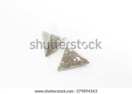 Two tea bags on white background  - stock photo
