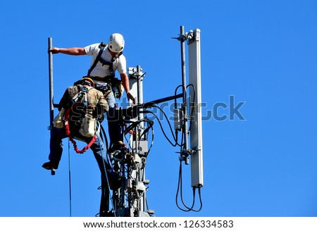 Two Technicians Working On A Telecommunication Tower - stock photo