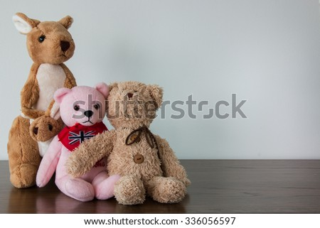 Two teddy bears and kangaroo toys   - stock photo