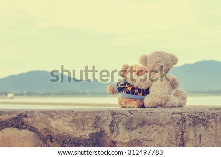Two teddy bears hugging. vintage style. - stock photo