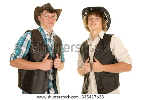 Two teen cowboys in their western hats showing some attitude. - stock photo