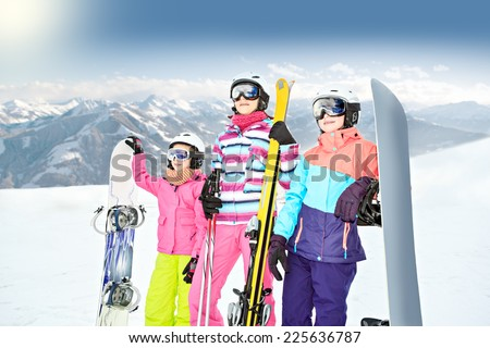 two teenage girl and a woman skiing alpin in the mountains - stock photo