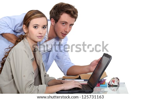 Two teenagers revising together - stock photo