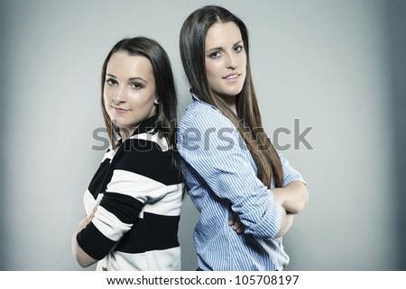 two teenagers with folded arms - stock photo