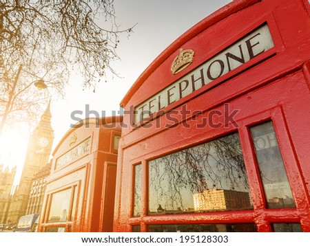 Two telephone boxes and the Clock Tower in London, UK - stock photo