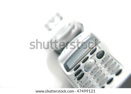 two telephones isolated on white, focus on talk - stock photo