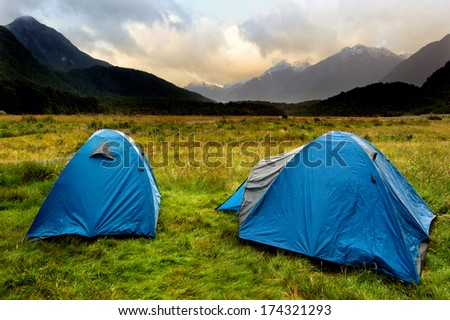 Two tents in campsite in Fiordland, New Zealand - stock photo