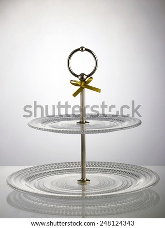 two tier plate on the with little ribbon - stock photo