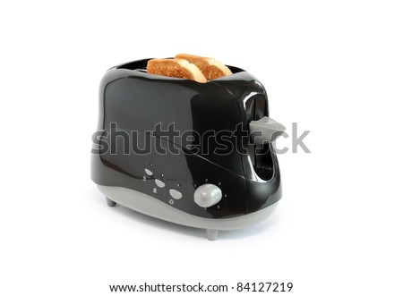 Two toasts inside black toaster on white background. Isolated with clipping path - stock photo