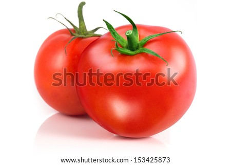 Two tomatoes isolated on a white background - stock photo