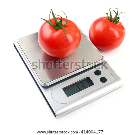 Two tomatoes with digital kitchen scales, isolated on white - stock photo