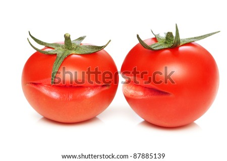 Two tomatoes with mouths - stock photo