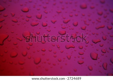 Two tone Cherry colored metallic water drop background - stock photo