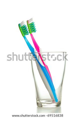 two toothbrushes in the glass isolated - stock photo