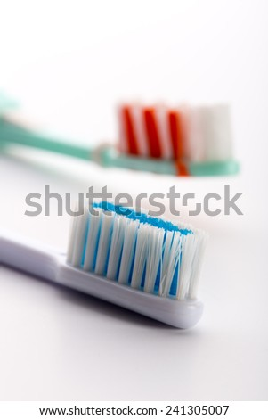 Two toothbrushes isolated on white - stock photo