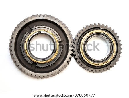 Two toothed gears isolated on white background. - stock photo