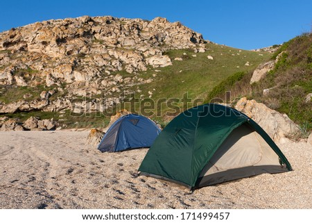 two tourists tents in mountain camp - stock photo