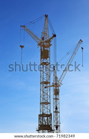 Two tower cranes on the skyline - stock photo