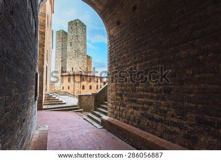 Two towers in the medieval Tuscan town of San Gimignano - stock photo