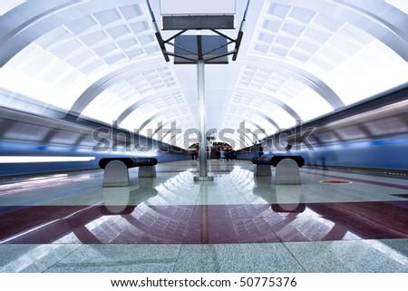 Two trains on underground platform - stock photo