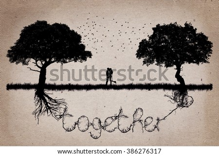 Two trees in front of each other with their roots growing  in shape of the word together and a couple hugging in the middle. Romantic scene. Relationship love and togetherness concept - stock photo