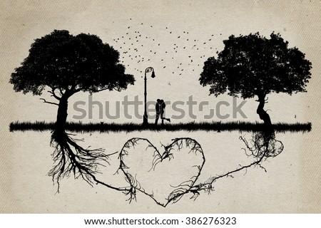 Two trees in front of each other with underground roots growing together in shape of a heart and a couple hugging in the middle. Relationship love and togetherness concept - stock photo