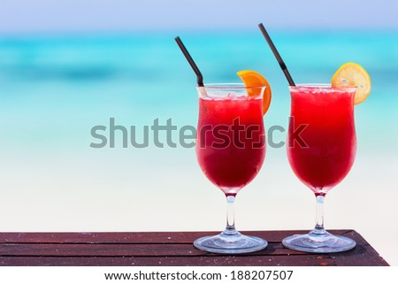 Two tropical cocktails served at beautiful beach - stock photo