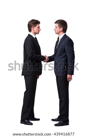Two twin brothers handshaking isolated on white - stock photo