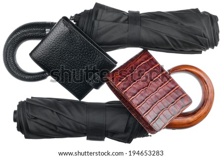 Two umbrellas and two purse, isolated on white background - stock photo
