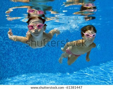 Two underwater girls - stock photo